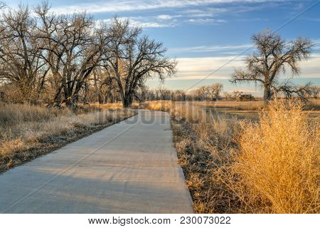 recreational trail along a river valley - Poudre River Corridor Trail near Winsor, Colorado