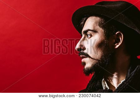 Portrait Of A Guy Who Is Posing In The Studio