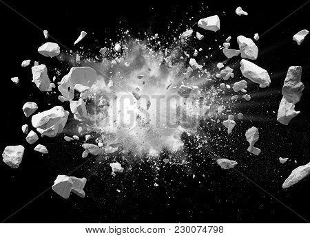 Split Debris Caused By Explosion Against Black Background