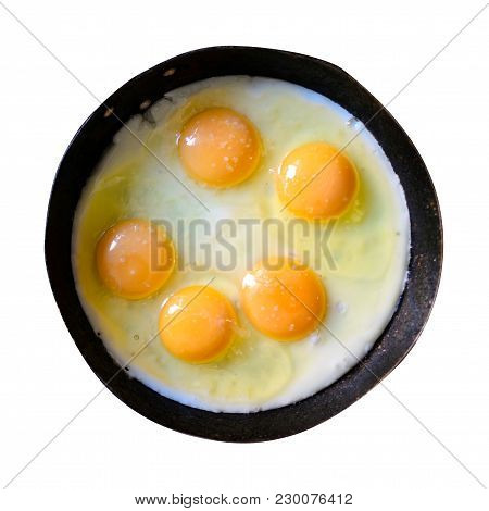 Appetizing Fried Several Eggs In A Cast-iron Frying Pan Isolated On White. Food Photo.
