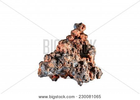 Macro Shooting Of Natural Gemstone. The Raw Mineral Is Goethite. Morocco. Isolated Object On A White