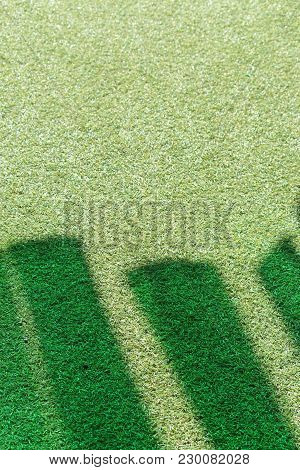 Emerald Green Colourful Shadows On Green Grass Astro Turf. Synthetic Grass