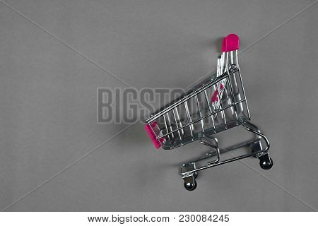 Shopping Cart Or Supermarket Trolley On Gray Background, Business Finance Shopping Concept.