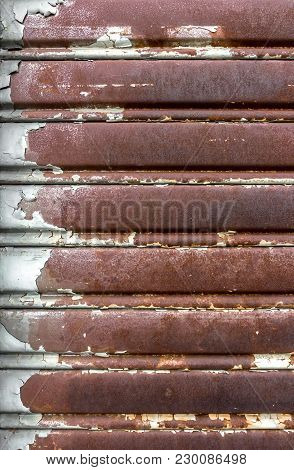 Rusty And Lowered Rolling Shutter With Parallel Lines. Vintage Style.
