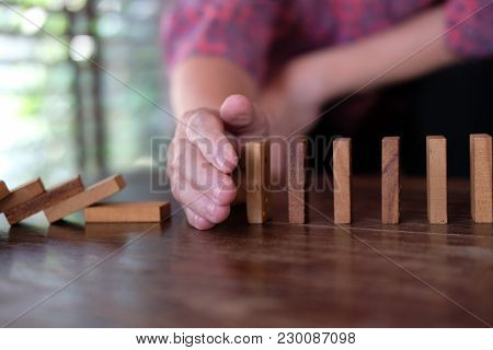 Hand Stopping Effect Of Domino Continuous Toppled. Woman Protecting Falling Wood Block. Solution & S