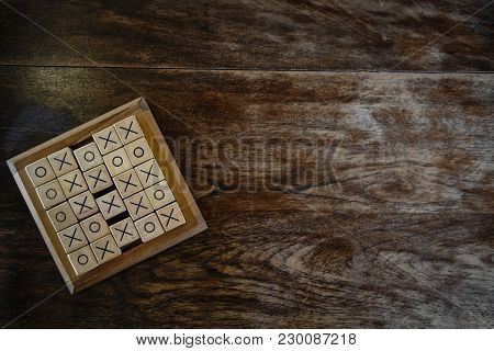 Ox Tic-tac-toe Game Made By Wood Block On Wooden Table. Education & Leisure Concept. Risk, Strategy,