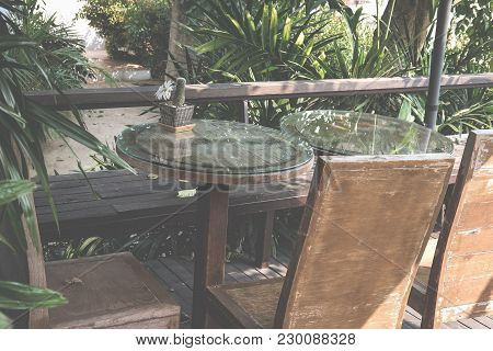 Round Table On Terrace Of House. Wood Chair On Patio Near Garden At Home. Relax Lifestyle Concept.