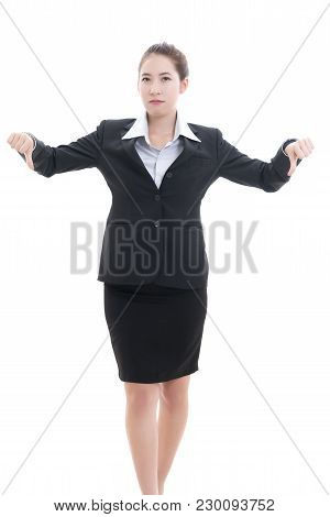 Young Asian Businesswoman In Black Suit And White Shirt Giving 2 Thumbs-down ( Hand Gesture Indicati