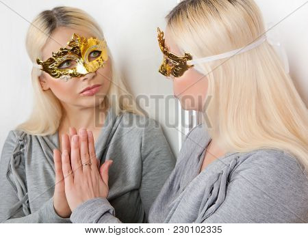 Masked Woman Touches Her Hand Reflection In The Mirror.