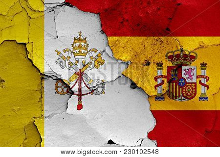 Flag Of Vatican And Spain  Painted On Cracked Wall