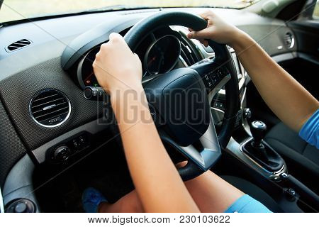 Close Up Of Steering Wheel In Female Driver Hands, Copy Space. Young Woman's Hands Holding Steering