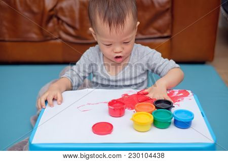 Cute Funny Little Asian 18 Months / 1 Year Old Toddler Baby Boy Child Finger Painting With Hands And