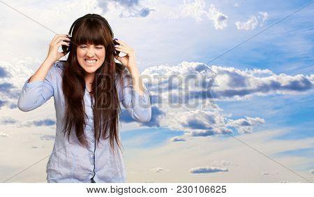 Irritate Girl listening Music, Outdoor