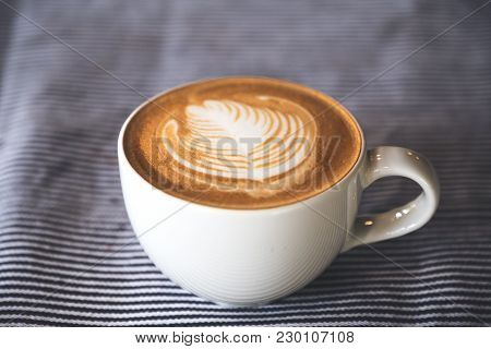 Closeup Image Of A Cup Of Hot Latte Coffee With Latte Art