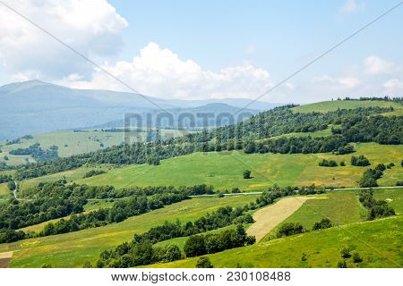 Fantastic View Of The Alpine Valley With Blue Sky A