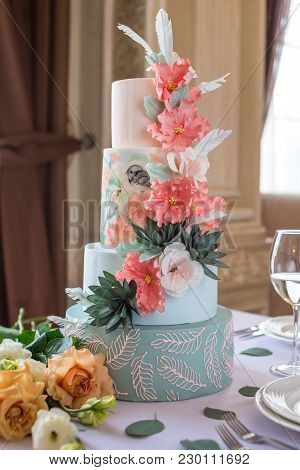 Home Wedding For-tiered Cake On The Table In The Restaurant Decorated With Pink Roses And Green Leav