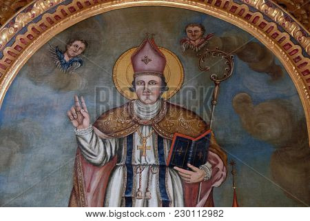 VUKOVOJ, CROATIA - OCTOBER 08: Saint Wolfgang, Bishop of Ratisbon, altarpiece in the chapel of St. Wolfgang in Vukovoj, Croatia on October 08, 2016.