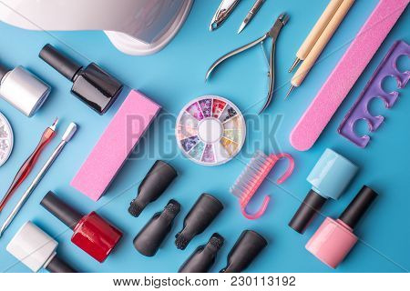 A Set Of Cosmetic Tools For Manicure And Pedicure On A Blue Background. Gel Polishes, Nail Files And