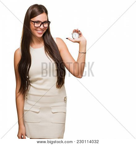 Portrait Of A Young Woman Holding Stopwatch And Wearing Specs On White Background