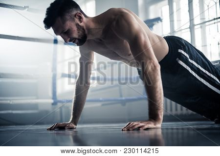 Man boxer training hard for a fight.