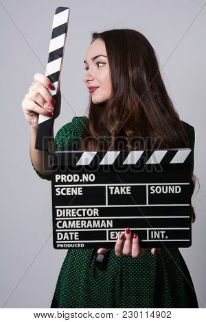 Face Aside Young Woman Holding A Movie Clapper