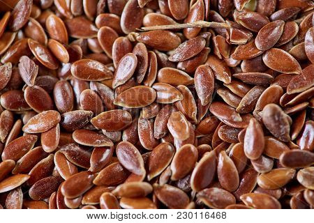 Selective Focus Close-up Picture Of Uncooked Healthy Nutritious Flax Seed Background. Macro, Selecti