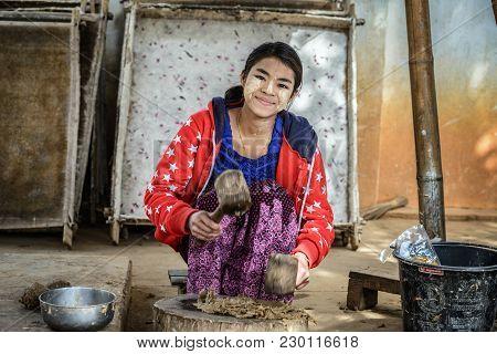 Pindaya, Myanmar - January 25, 2016 : Young Woman Prepares Substance For Traditional Umbrella Making