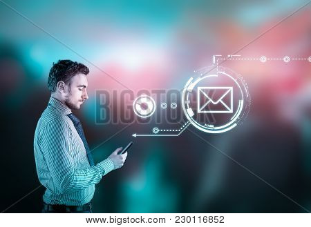 Businessman Using Smarphone On Abstract Background With Bokeh Lights. Sending A Message Hologram.