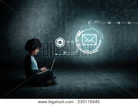 Man Using Laptop, Hologram Of A Digital Screen With Sending Message Icon.