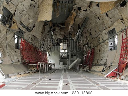 Interior Of Old Military Airplane Cabin. Airplane Cabin Is Defective.