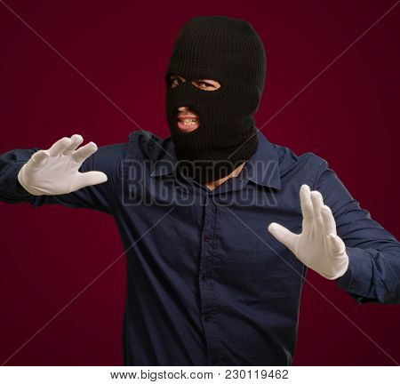 Burglar In Face Mask Isolated On Coloured Background
