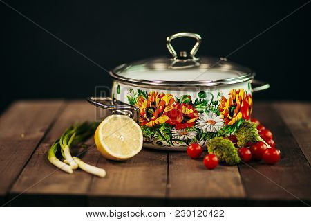 Ironpan With Products On Wooden Background. Cool