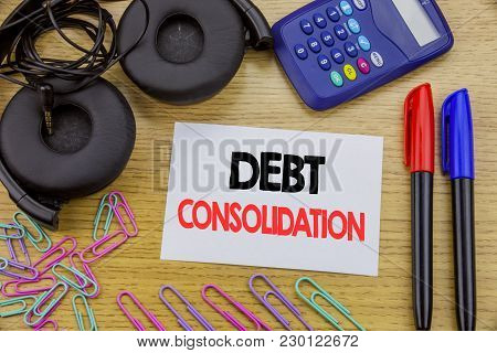 Writing Text Showing Debt Consolidation. Business Concept For Money Loan Credit Written On Sticky No