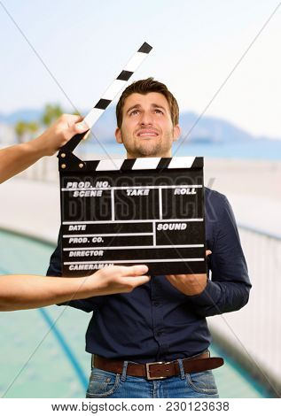 Director Clapping The Clapper Board, Outdoor