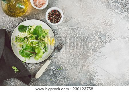 Fresh Green Mix Salad With Romaine, Frisee And Chard Lettuce Leaves. Top View With Place For Text
