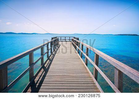Wooden Pier Or Jetty, Passignano Sul Trasimeno, Trasimeno Lake, Umbria Italy Europe.
