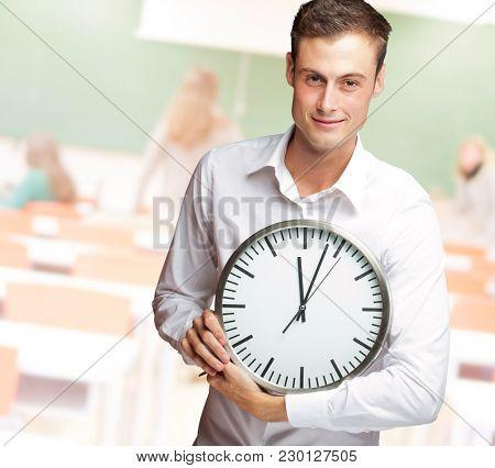 Happy Man Holding Clock In His Hand, Indoor