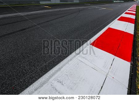 Asphalt Red And White Kerb Of A Race Track Detail