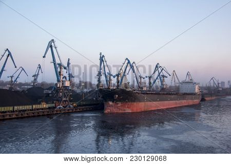 shipping containers and gas oil tanks at the docks. in import export and business logistic. Cargo sh
