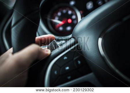 Automatic Transmission Paddle Shift Driving Concept. Caucasian Driver Hand On The Left Side Steering