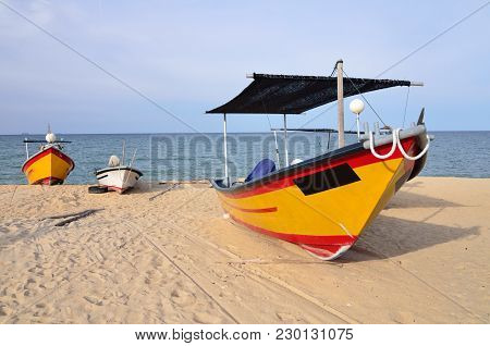 Fisherman Boat On The Beach With One Of It Placed Infront