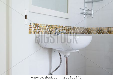White Basin In The Bathroom,wash Bowl In Lavatory Or Toilet