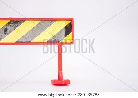 Road Closed Barricade On White Background Ideal For Maintenance And Construction Concept