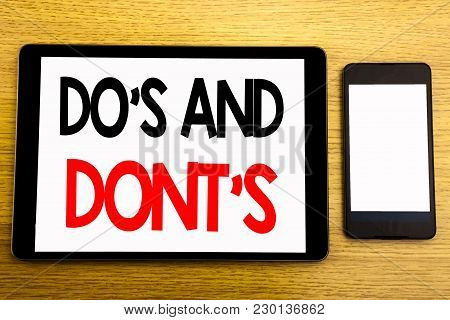 Writing Text Showing Do S And Do Not Donts. Business Concept For Guide Allowed Written On Tablet, Wo