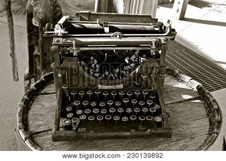 A Very Old Decrepit Typewriter With Jammed Keys And Letter Identification Gone. (black And White)
