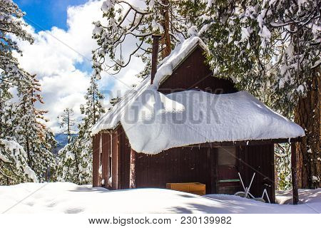 Wooden Cabin Buried With Heavy Snowfall In Mountains