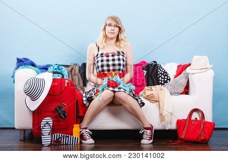Packing Problems, Necessary Things During The Trip Concept. Tired Woman Sitting On Sofa, Getting Rea