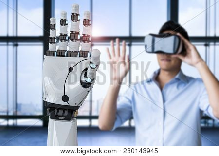 Asian Man Wearing Vr Headset And Control 3d Rendering Robot Hand