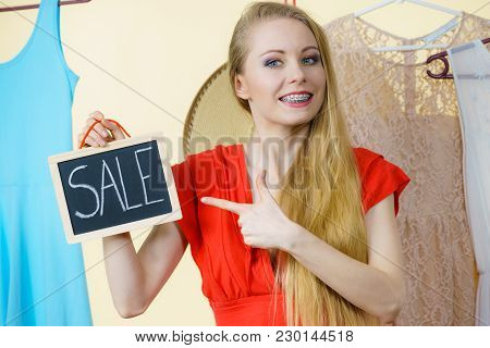 Woman In Clothes Shop Store Holding Black Board With Sign Sale, Picking Summer Perfect Outfit, Dress