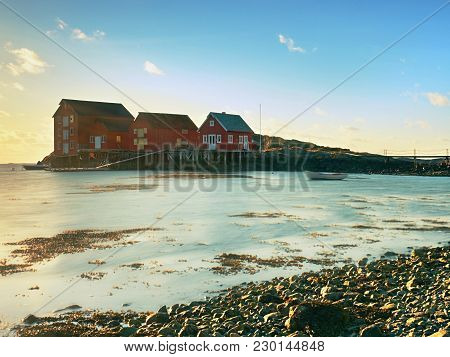 Beautiful View On Norwegian Bay With Traditional  Houses Along Rocky Coastline. Outdoor Spring Shot